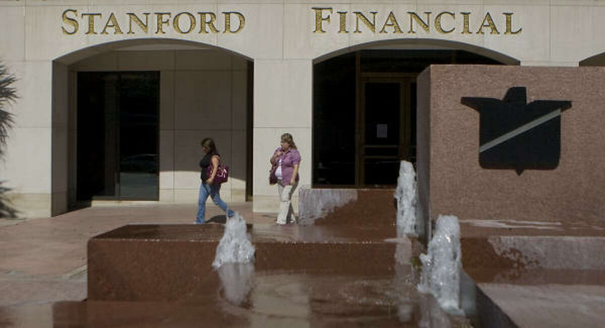 Rosa Arizaga, left, and her mother Adela Miramontes, an investor with Stanford Financial group, walk away from the building after they found the doors locked Thursday.