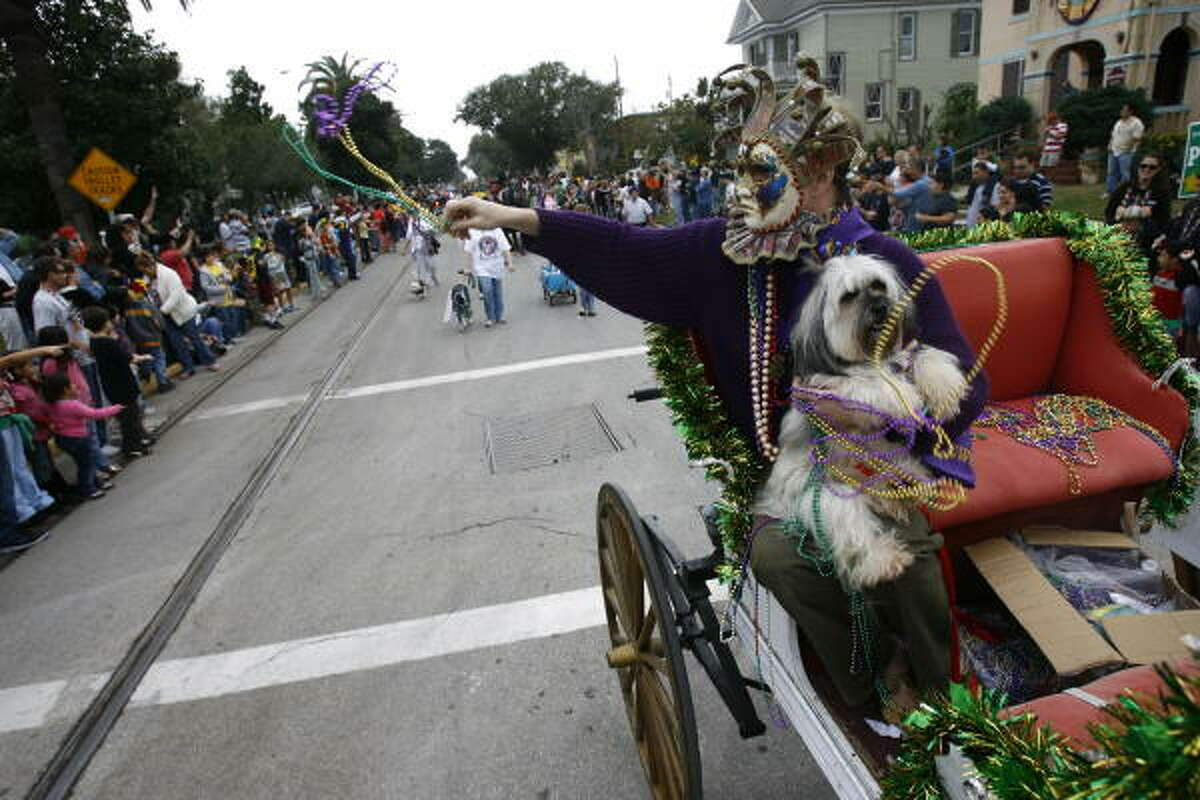 Lawren Hall threw beads as she escorted the Queen Daisy Doodle at the front of the the Krew of Barkus and Meoux Mardi Gras Parade last year.