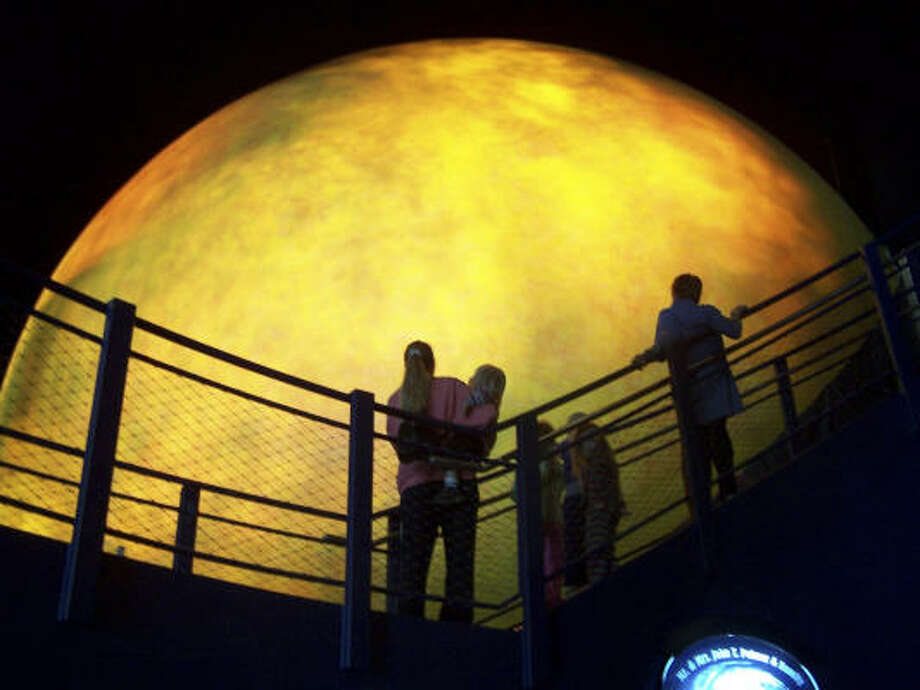 At the Sci-Port Discovery Center, visitors cann look at the outer Sun Shell of the Sci-Port Discovery Centers Space Dome Planetarium in Shreveport, La. Photo: April Barton, Associated Press
