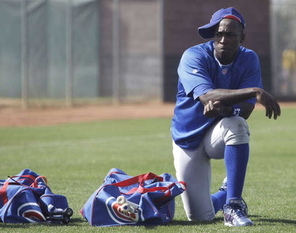 Chicago Cubs' Alfonso Soriano takes a break during spring training.