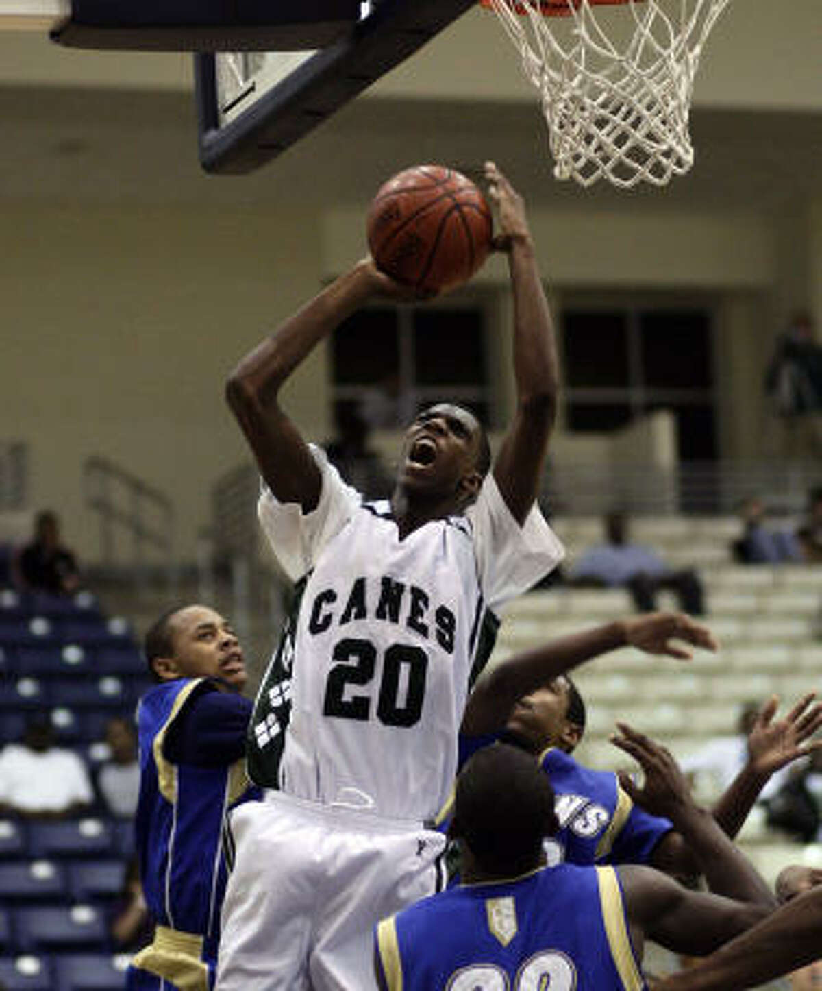 Hightower's Winston Sheppard goes up strong for a basket after grabbing an offensive rebound.