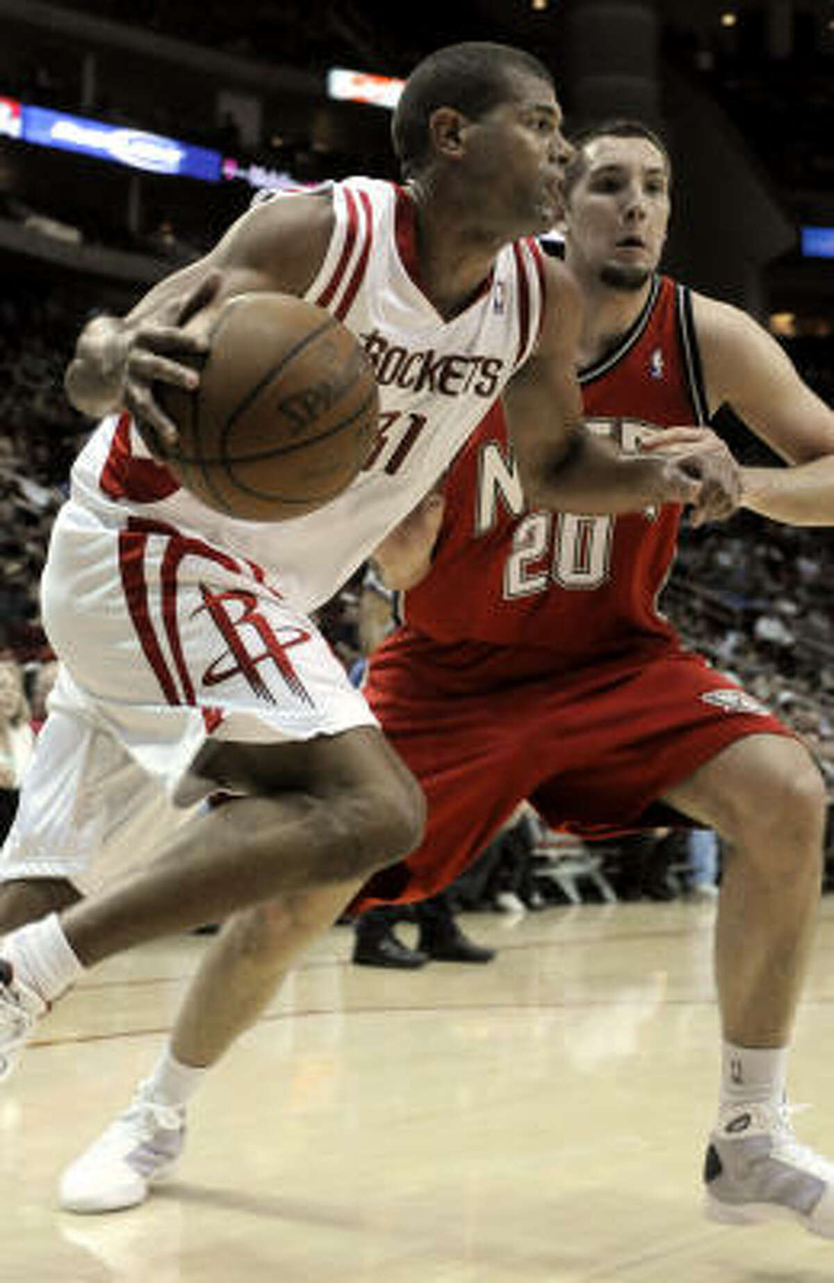 Shane Battier (31) drives against New Jersey's Ryan Anderson (20) during the second half.