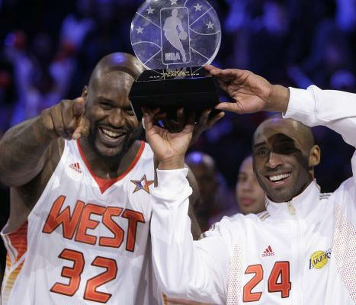 Western Conference center Shaquille O'Neal (32), of the Phoenix Suns, and Western Conference guard Kobe Bryant (24), of the Los Angeles Lakers, share the MVP award after the NBA All-Star Game.