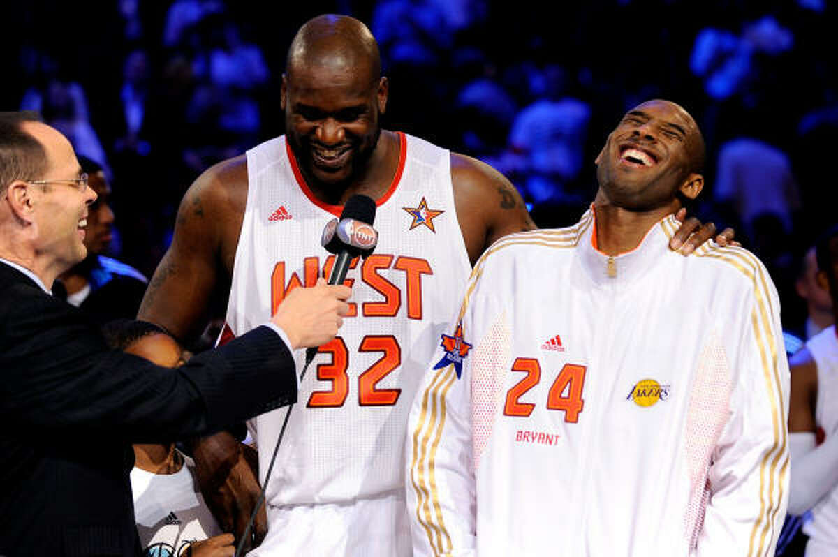 Co-MVPs Shaquille O'Neal (32) and Kobe Bryant (24) of the Western Conference are interviewed by TNT's Ernie Johnson.