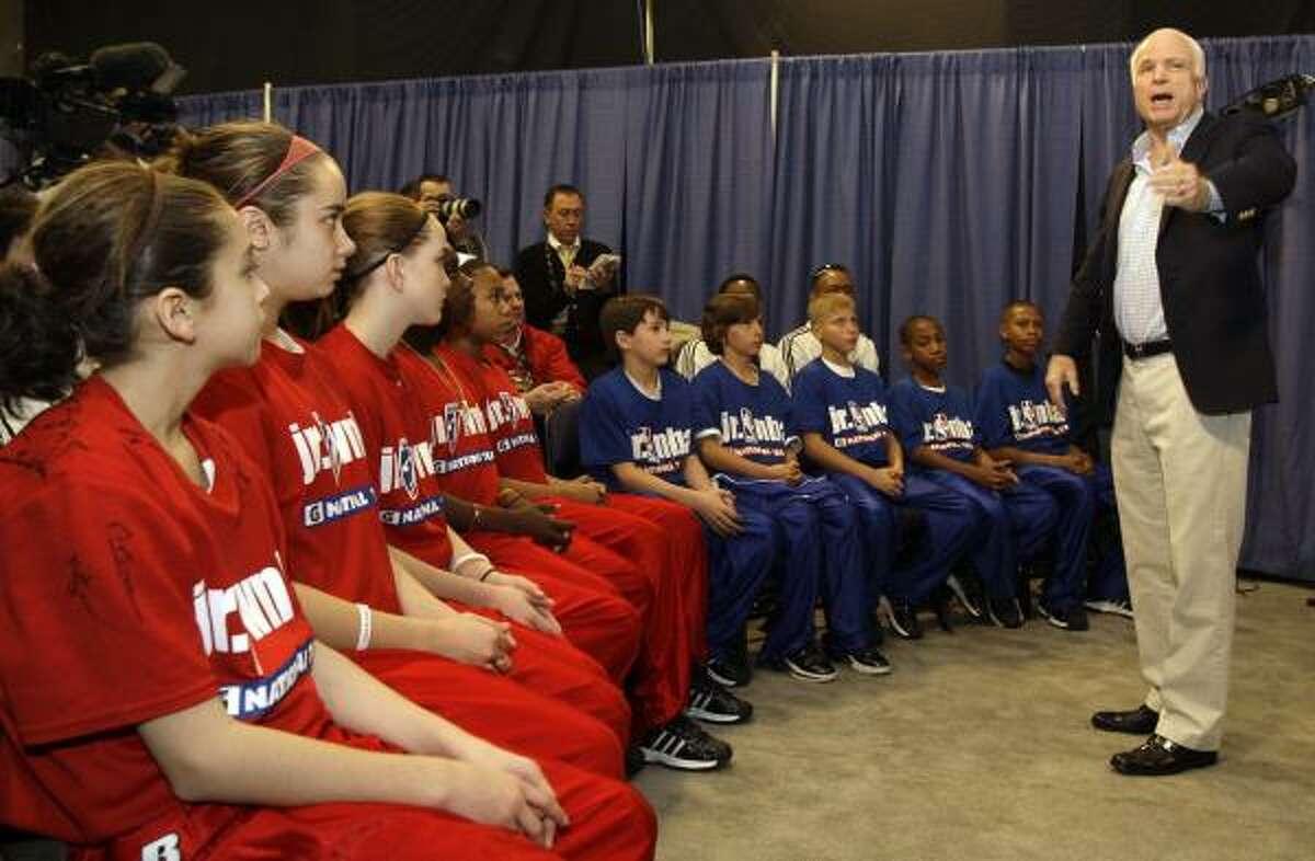 Senator John McCain, R-Ariz., talks boys and girls selected by the NBA to the 2009 Jr. NBA/Jr. WNBA National Team before the start of the NBA All-Star game.
