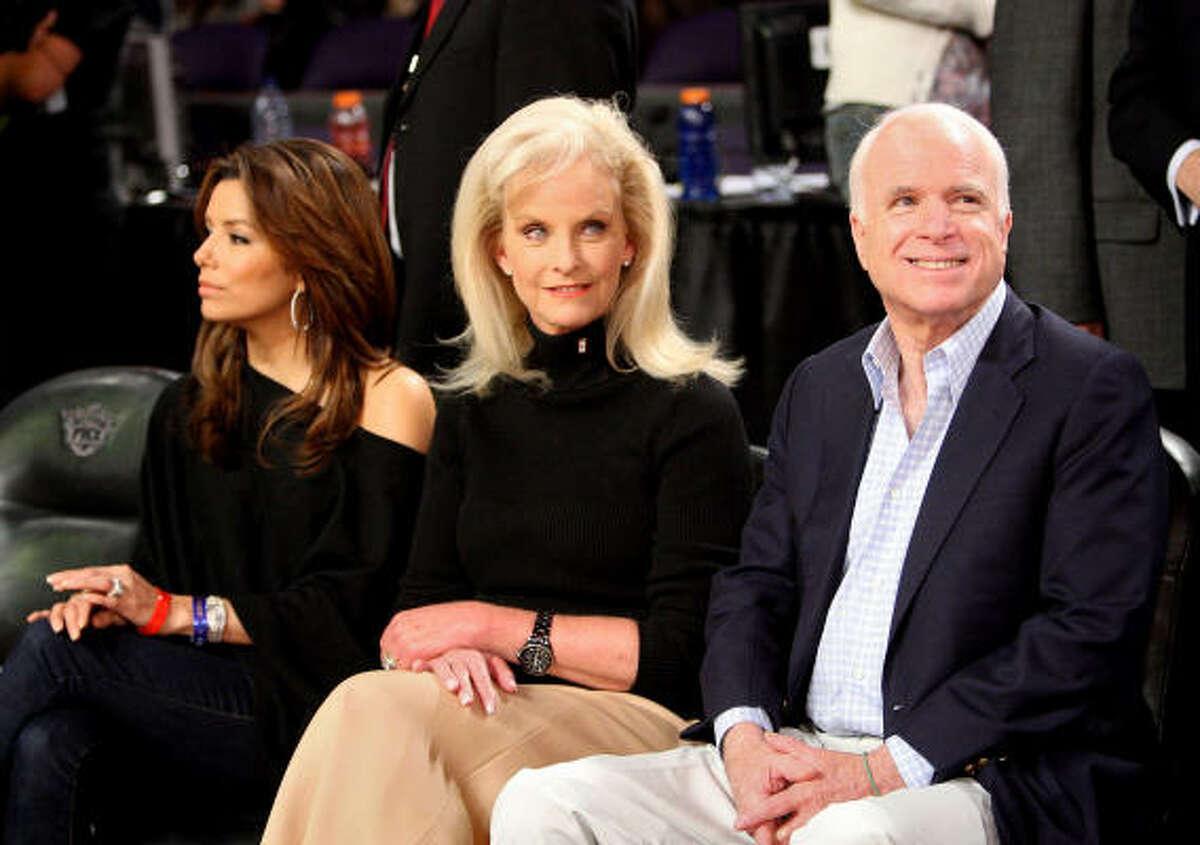 (L-R) Actress Eva Longoria Parker, Cindy McCain, and senator John McCain pose in the audience.