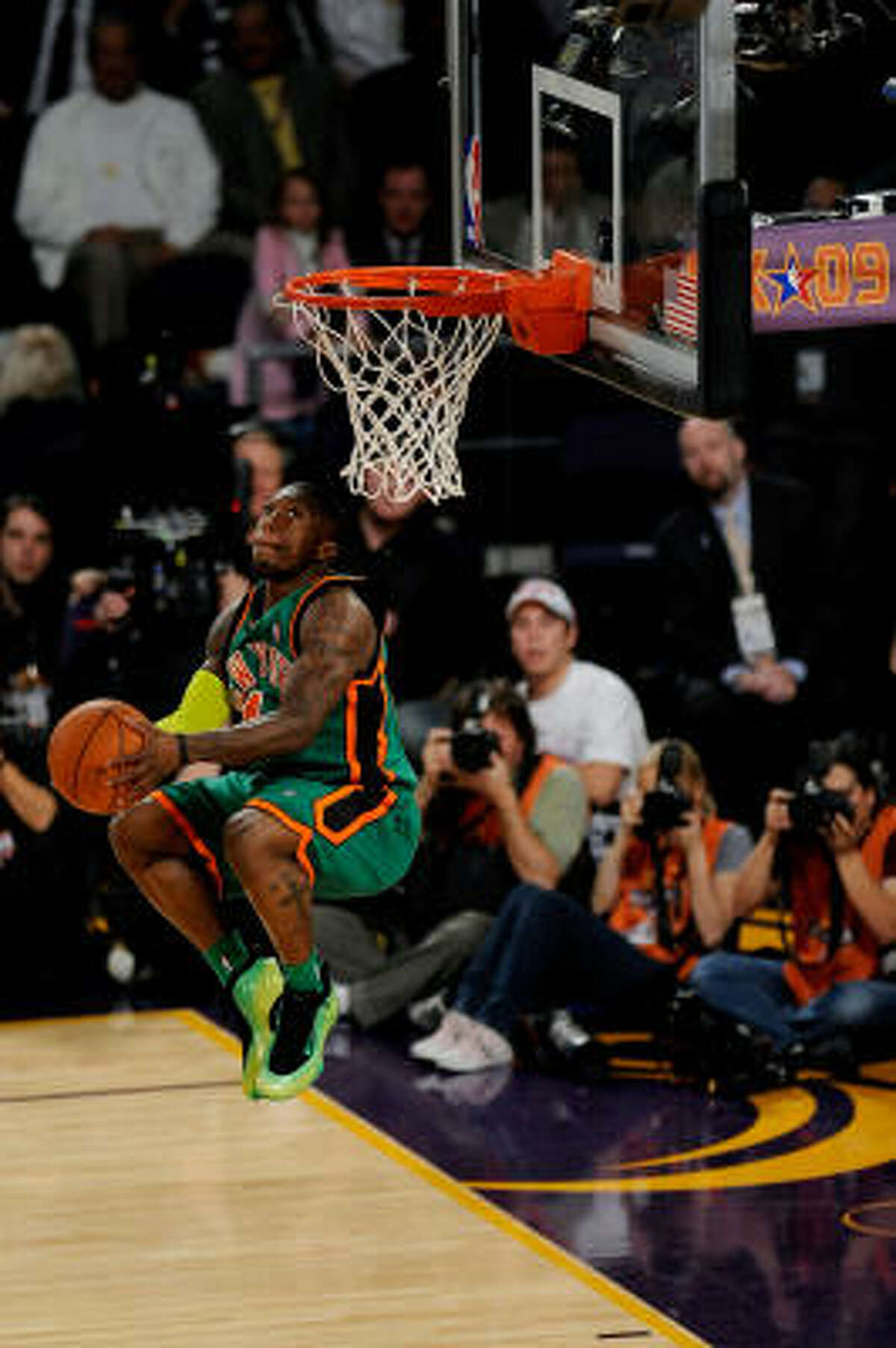 New York's Nate Robinson sends home a dunk in the finals of the Sprite Slam Dunk Contest.