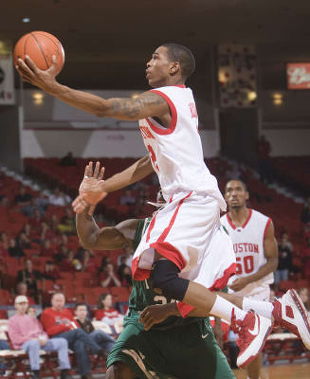 Houston's Zamal Nixon goes for a layup in the game against Tulane at the Hofheinz Pavilion.
