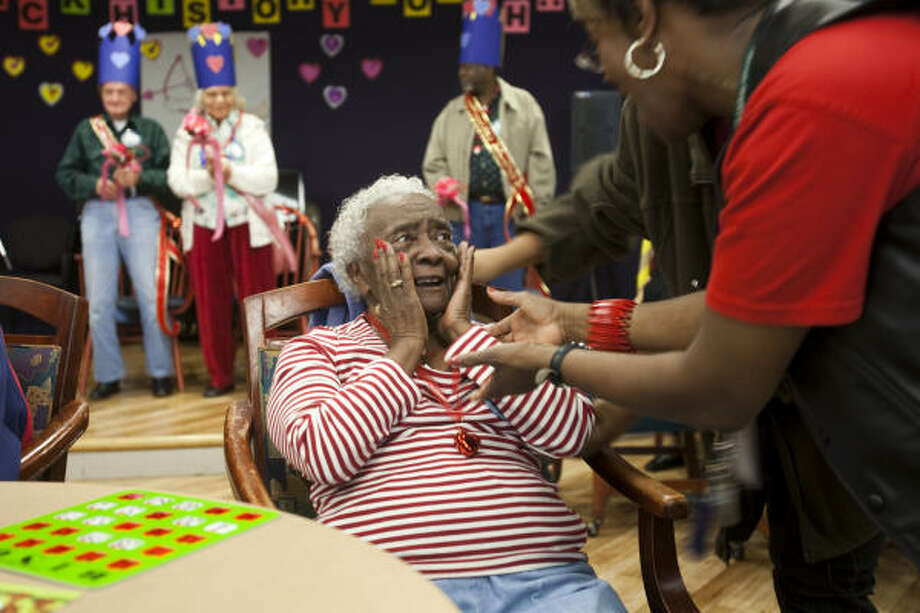 Juanita Bell, 82, reacts  after she was announced as the 2009 Sheltering Arms Valentine's Queen during a holiday party at the Sheltering Arms Adult Day Center. Photo: Smiley N. Pool, Chronicle