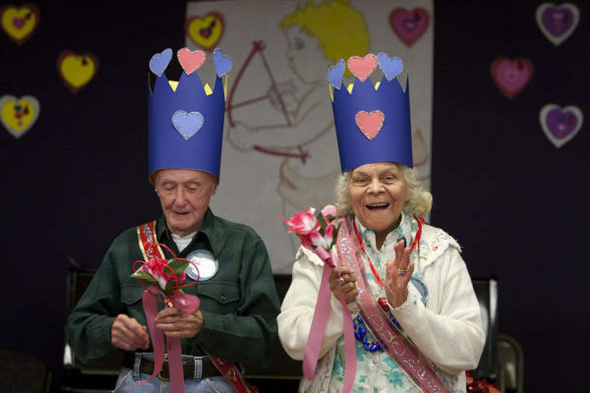 Robert Murphy and Daisy Marshburn applaud after they were crowned the 2009 Sheltering Arms Valentine's Duke and Duchess.