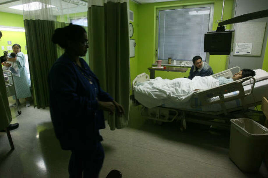 (Left to right) Cinthia Hernandez, 19, carries her two day old son Dominick Palma as Nabor Miranda and Inocencia Aguilar wait for the nurse to bring in their twin boys into the a semi-private room at Ben Taub General Hospital on Wednesday, Feb. 4, 2009 in Houston, TX.  The Harris County Hospital District is turning four-bed maternity wards into semi-private rooms and giving expectant mothers tours of the obstetrical suites in an effort to win back business from women whose deliveries will be covered by Medicaid. The hospital district has experienced a significant decrease in Medicaid revenue this year, and officials said the flight of pregnant women to private hospitals is partly to blame. The number of babies born at Ben Taub General Hospital and Lyndon B. Johnson General Hospital has fallen from 11,300 in the 2007 fiscal year to an expected 9,500 in the fiscal year that ends next month. Photo: Mayra Beltran, Houston Chronicle