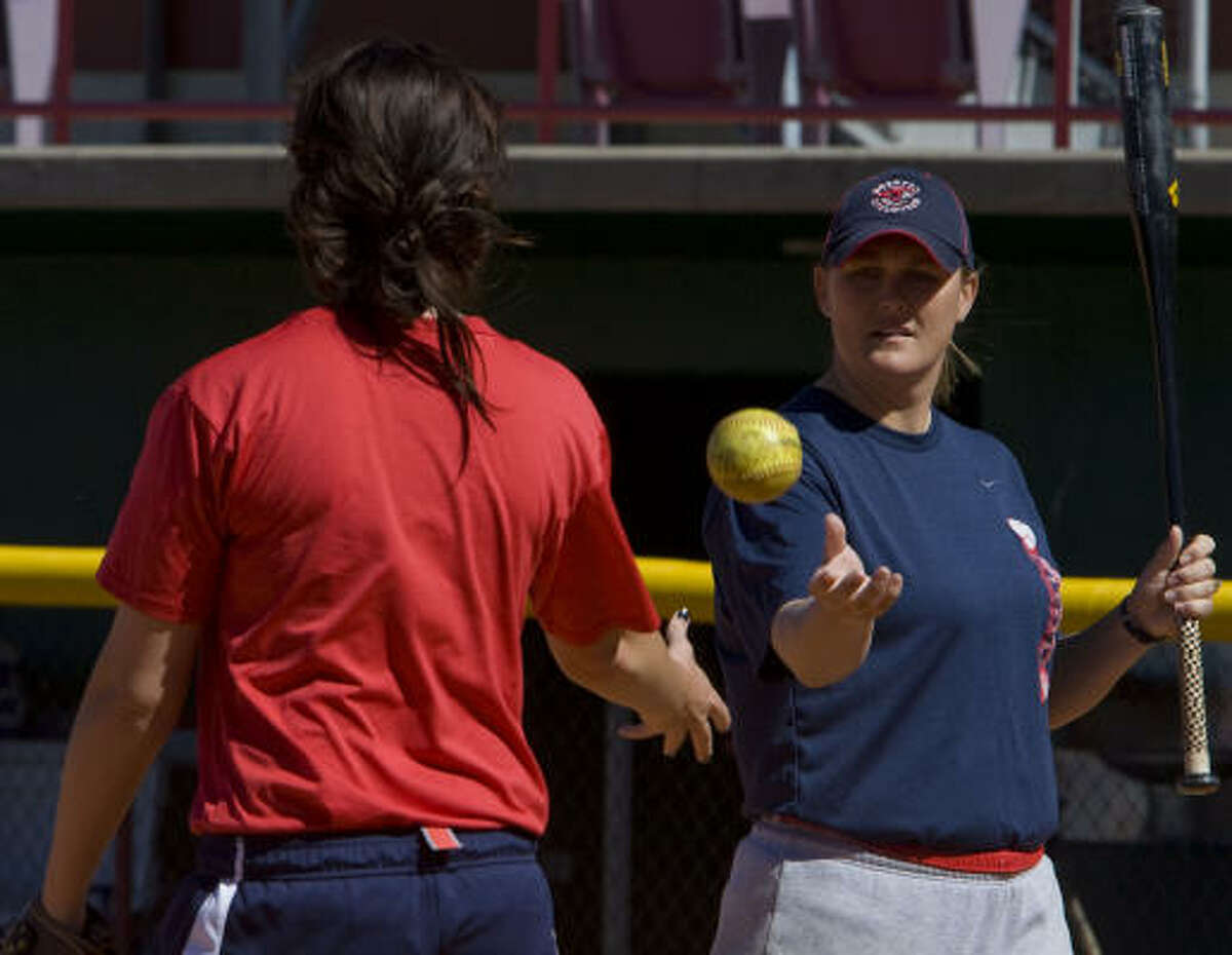 UH softball coach Kyla Holas (right) has led the Cougars to seven consecutive winning seasons.