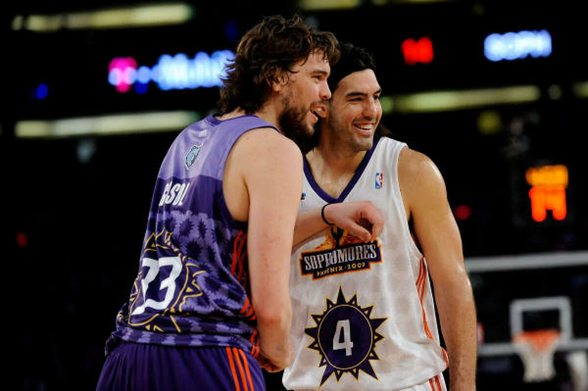 Memphis Grizzlies rookie center Marc Gasol and Rockets sophomore forward Luis Scola share a laugh during the game.