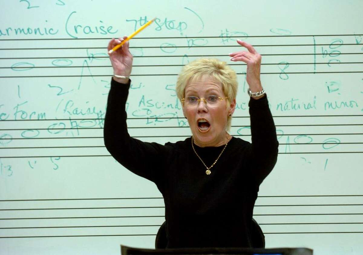 The Mendelssohn Choir rehearses at Staples High in Westpost, Conn. on Tuesday Sept. 29, 2009. Here, conductor Dr. Carol Ann Maxwell directs the choir through