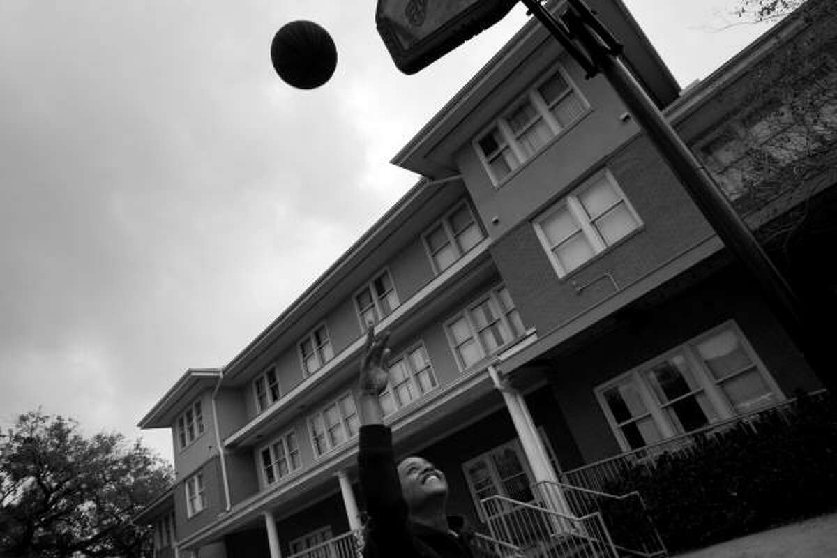 Corderro shoots baskets outside the shelter where he lives. For 25 years Covenant House Texas has provide shelter and support to throwaway and runaway youth in Houston.