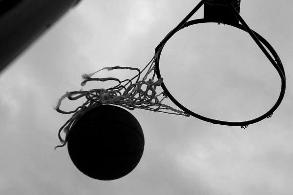A tattered net does little to catch the ball as Corderro shoots baskets.