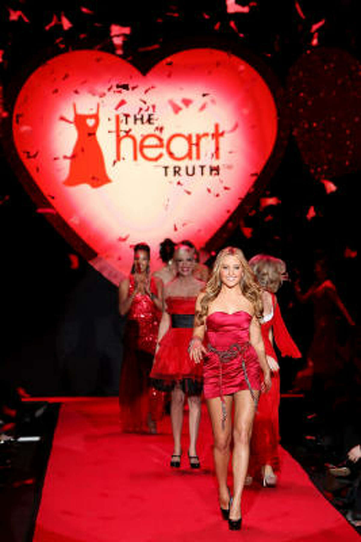Actress Amanda Bynes leads a parade of celebrities down the runway at the Heart Truth Red Dress Collection Fall 2009 fashion show during Mercedes-Benz Fashion Week.