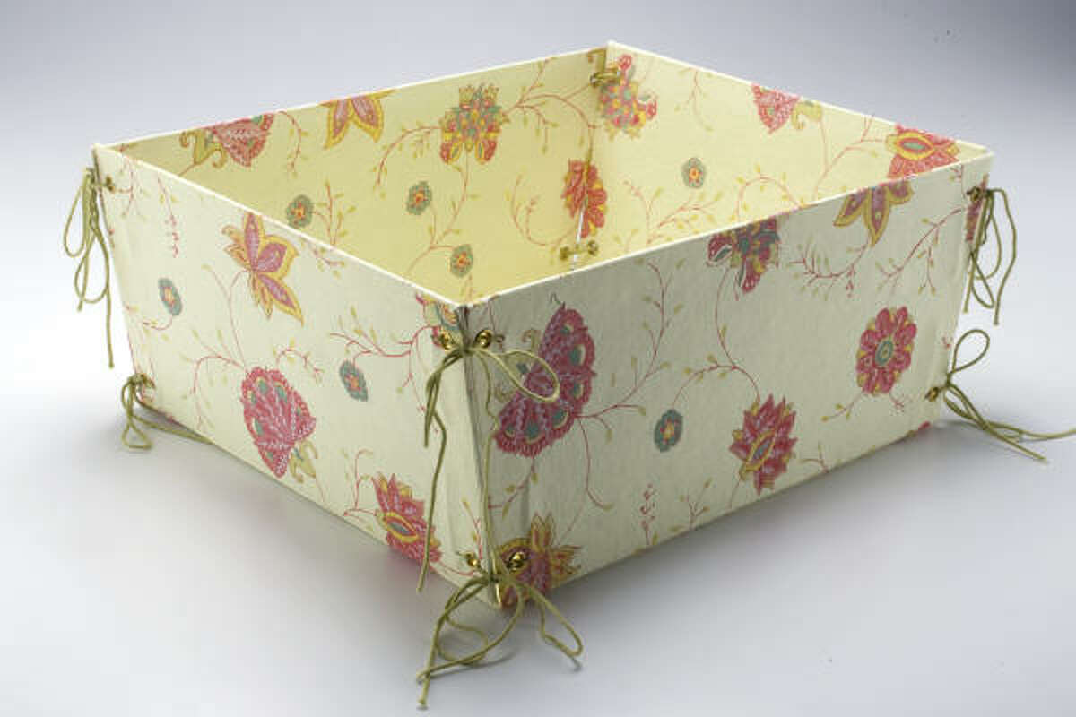 Ideal for delicate sundries, this basket is crafted from 100 percent recycled, handmade paper. Sold flat, it comes with strings that you loop through corner grommets to secure the sides. $3.48 at Cost Plus World Market; worldmarket.com.