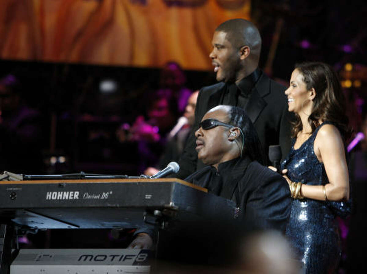 Stevie Wonder performs on stage with Actors Tyler Perry and Halle Berry during the 40th NAACP Image Awards held at the Shrine Auditorium in Los Angeles.
