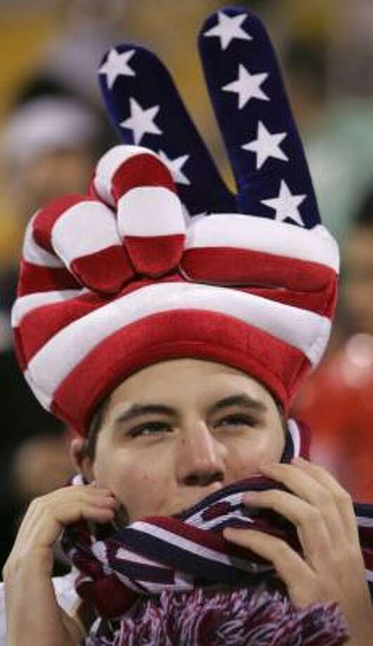 U.S. 2, Mexico 0Rolland Perry, from Fort Wayne, Ind., bundles up before the start of a World Cup qualifying soccer match. Photo: Paul Vernon, AP