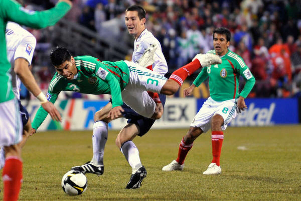 U.S. 2, Mexico 0 Carlos Salcido #3 of Mexico goes airborne after being upended by Sacha Kljestan #16 of Team USA.