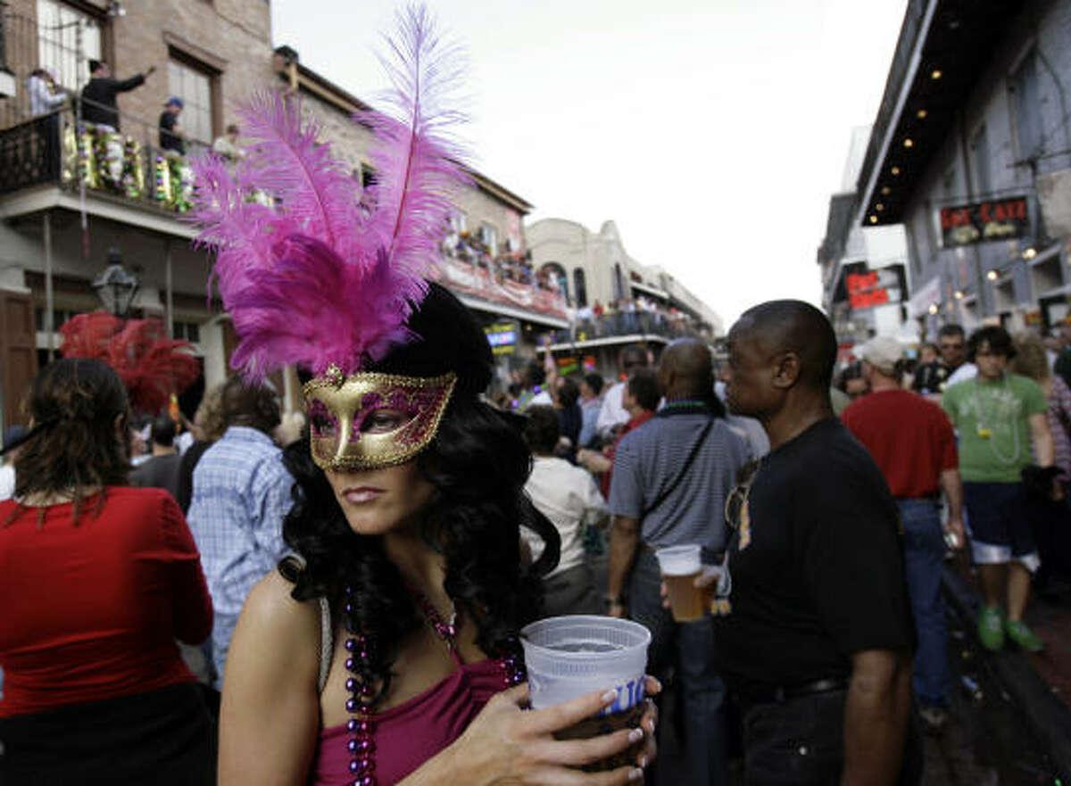 Bobbi Duncan holds a beer on Bourbon Street.