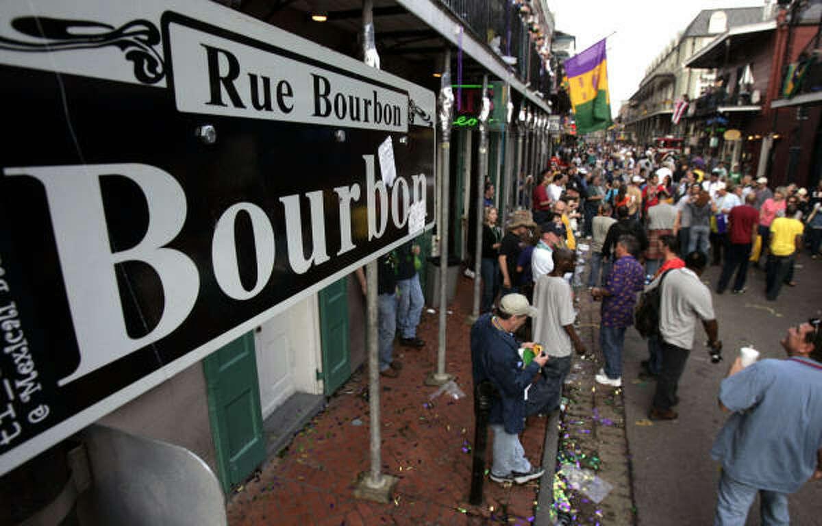 Mardi Gras revelers on Bourbon Street.
