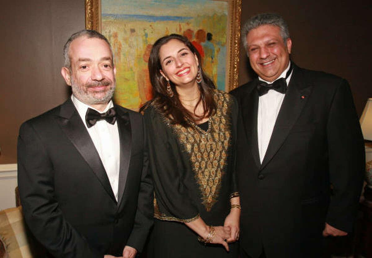 Novelist Rabih Alameddine, left, with chairs Zeina and Nijad Fares