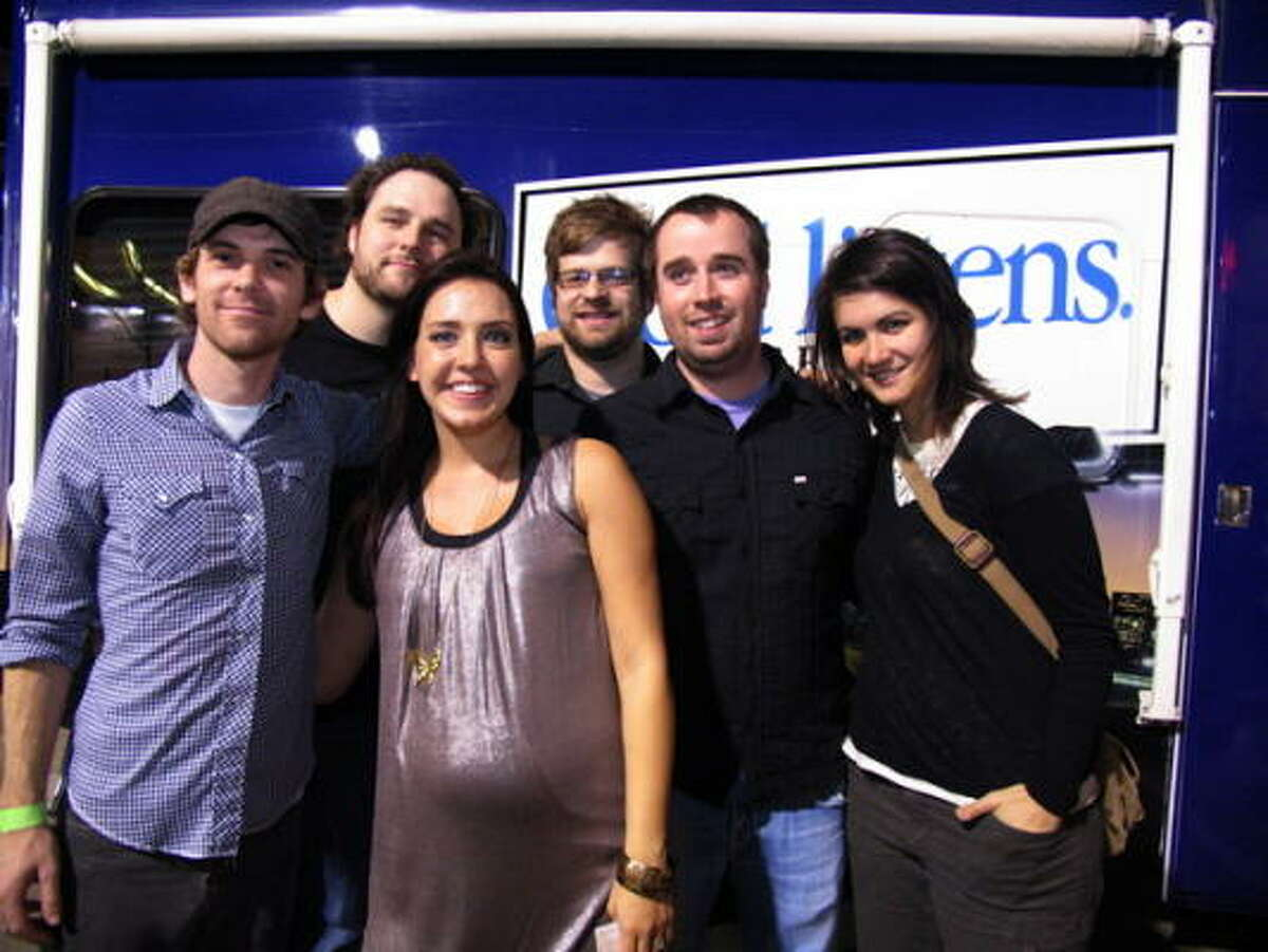 Addison Road and KSBJ Afternoon Show Host Liz Jordan pose for a group photo after the show.