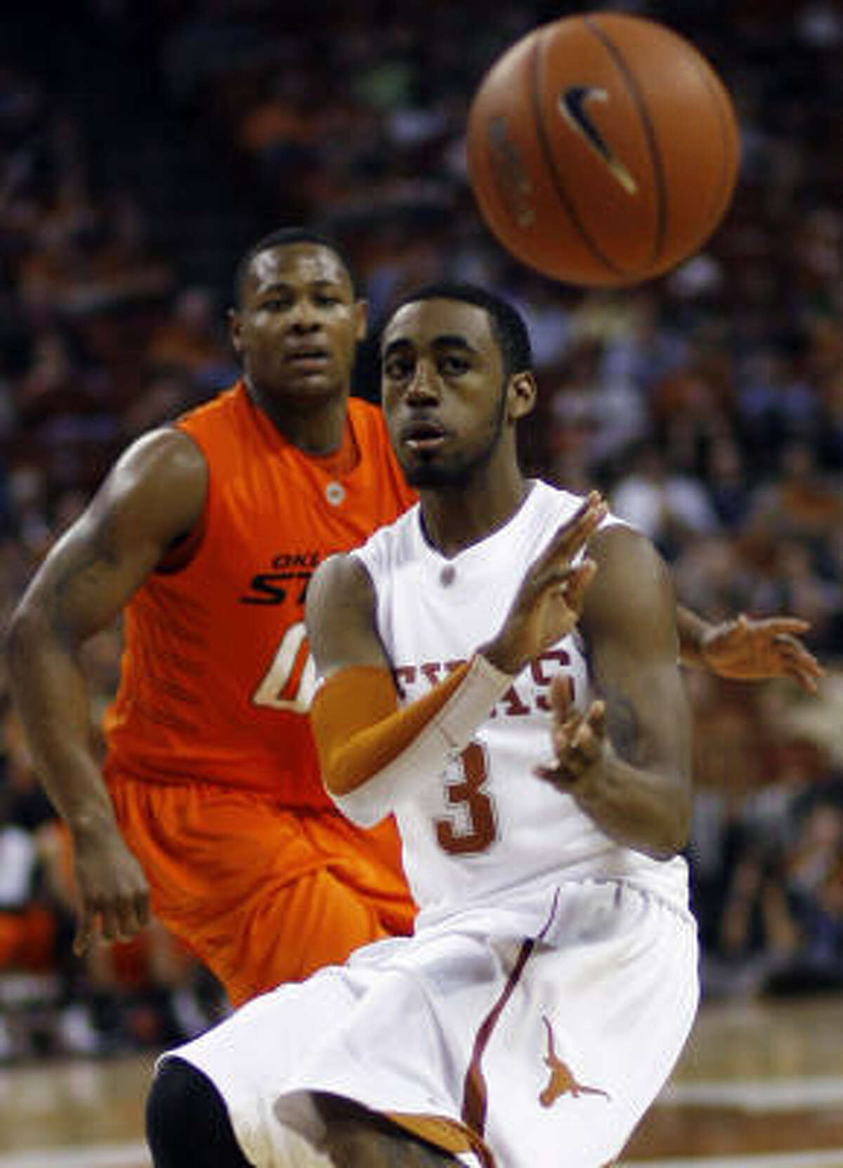 Texas guard A.J. Abrams passes the ball during the second half against Oklahoma State on Tuesday in Austin. Abrams' team-high 20 total points helped Texas to a 99-74 victory.