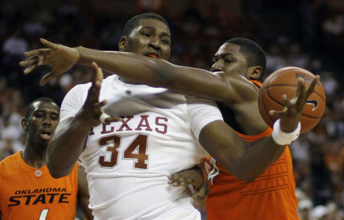 Texas center Dexter Pittman, left, is fouled by Oklahoma State forward Malcolm Kirkland.
