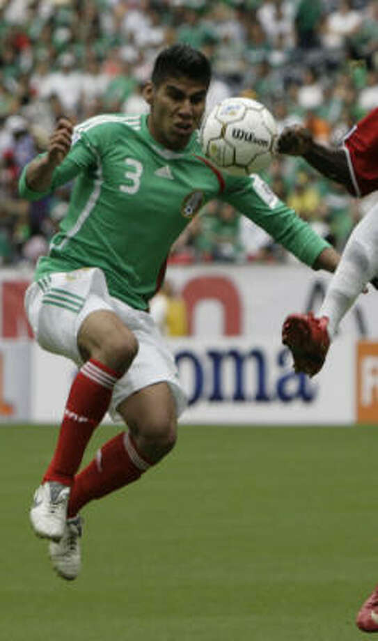 Defender: Carlos Salcido Club: PSV Eindhoven Photo: Julio Cortez, Houston Chronicle