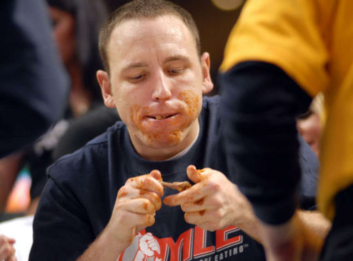 Joey Chestnut eats buffalo wings on his way to winning the Wing Bowl 16 at the Wachovia Center Feb. 1, 2008 in Philadelphia, Pennsylvania. Over 20,000 people came to watch Chestnut win Wing Bowl 16 by eating 241 buffalo wings.
