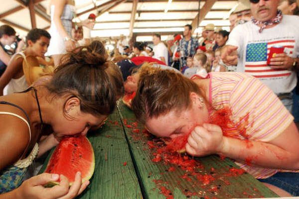 Contestants Ashley Mikesh, left, and Christi Rheinboldt compete in a watermelon eating contest at the Luling Watermelon Thump in Luling, Texas, in this 2003 photo. Rheinboldt, who had won 11 times in the past, was crowned this year's champ.