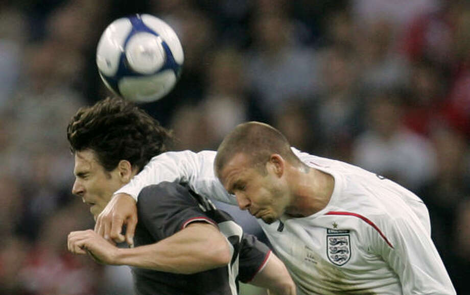 Defender: Heath Pearce Club: Hansa Rostock (Germany) Career Caps: 21 Pearce, left, battles England's David Beckham in an international match in 2008. Photo: ALASTAIR GRANT, AP