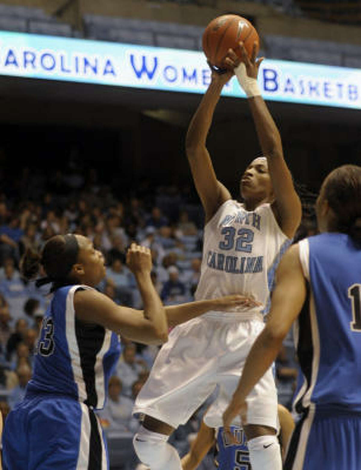 North Carolina's Rashanda McCants (32) shoots over Duke's Karima Christmas (left) and Chante Black, right, in the second half of Monday's game in Chapel Hill, N.C. McCants scored 22 points in No.8 North Carolina's 75-60 win over the fourth-ranked Blue Devils.