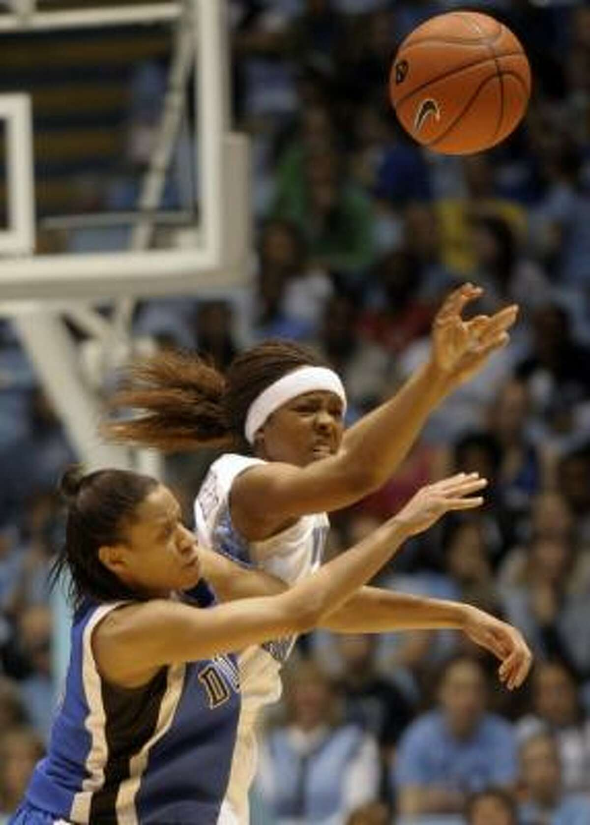 Duke's Jasmine Thomas, left, collides with North Carolina's Cetera DeGraffenreid in the second half.
