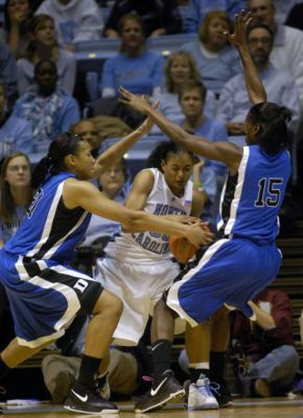 North Carolina's Italee Lucas, center, is pressured by Duke's Joy Cheek, left, and Bridgette Mitchell during the second half.