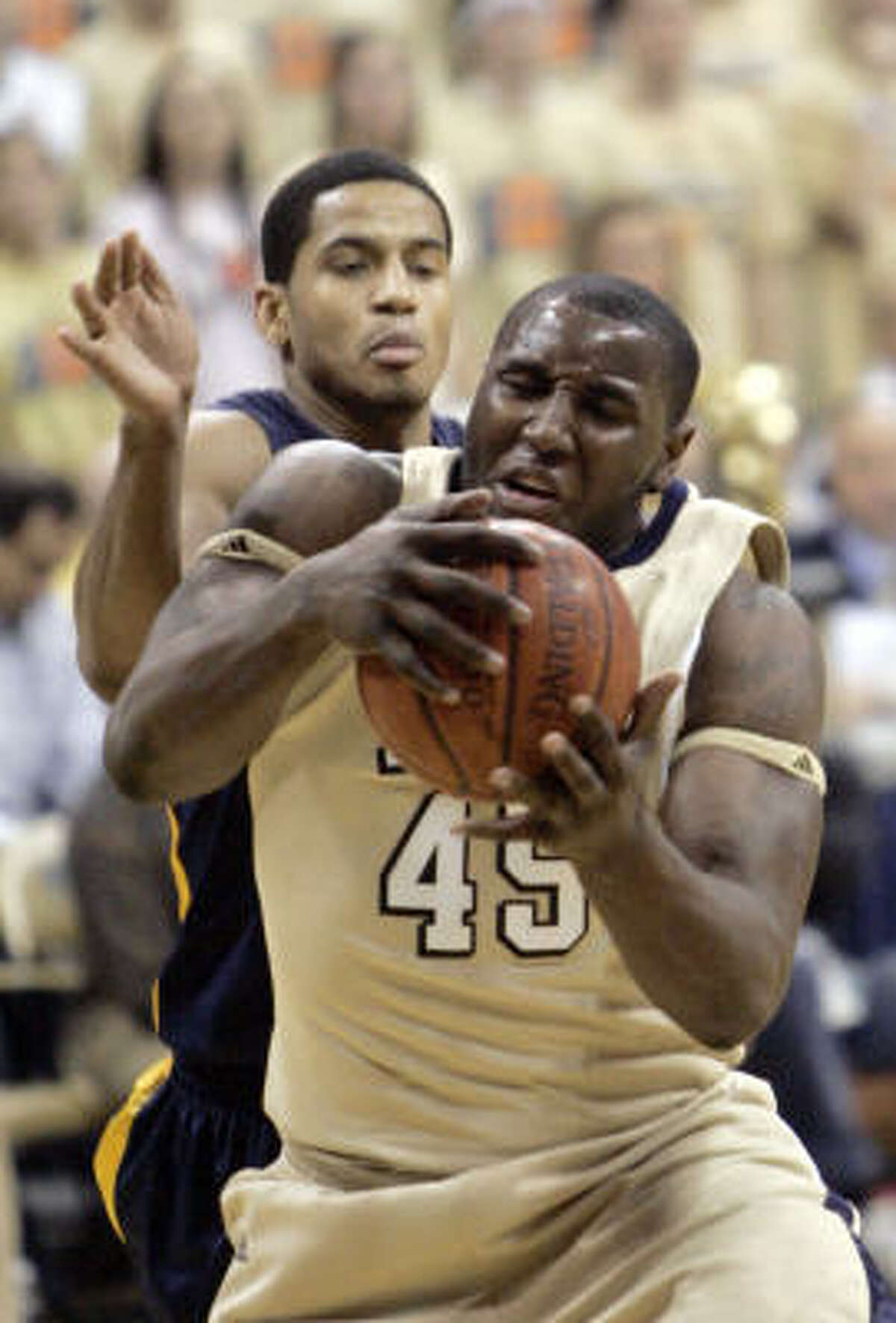 Pittsburgh's DeJuan Blair, right, grabs a rebound in front of West Virginia's Wellington Smith in the second half.