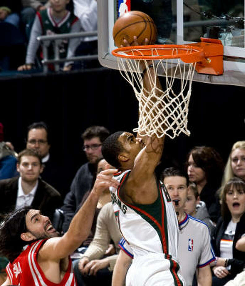 Bucks guard Ramon Sessions, right, puts up a shot against Luis Scola in the first half. Sessions scored a game-high 26 points in 33 minutes. Photo: Tom Lynn, MCT