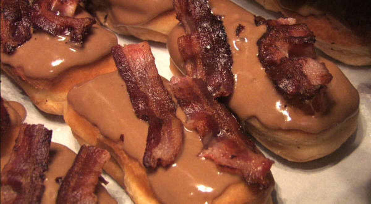 Bacon Maple Bar is a doughnut topped with maple, and bacon of course.