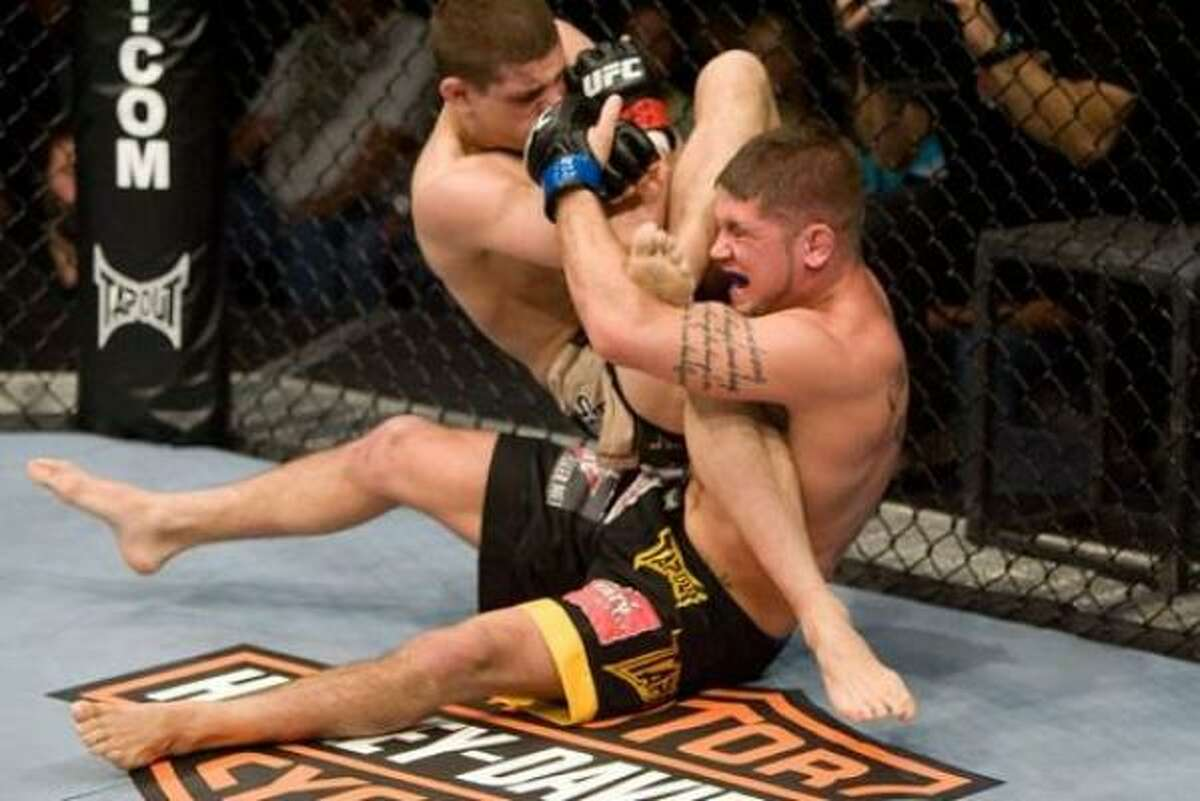 Joe Lauzon (left) defeated Jeremy Stephens via arm bar submission in round 2 of the main event at UFC Fight Night 17.