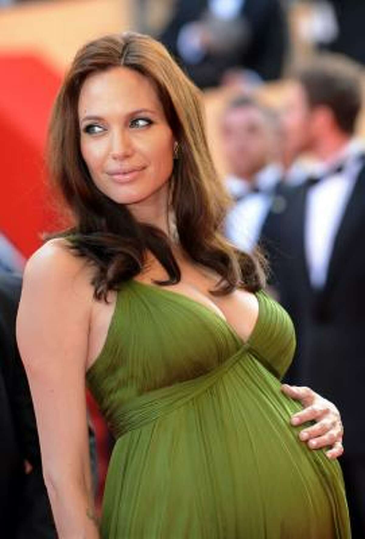 Angelina Jolie looks fabulous while carrying twins. Maternity-wear designer Liz Lange says pregnant women shouldn't be afraid to add color to their wardrobe.