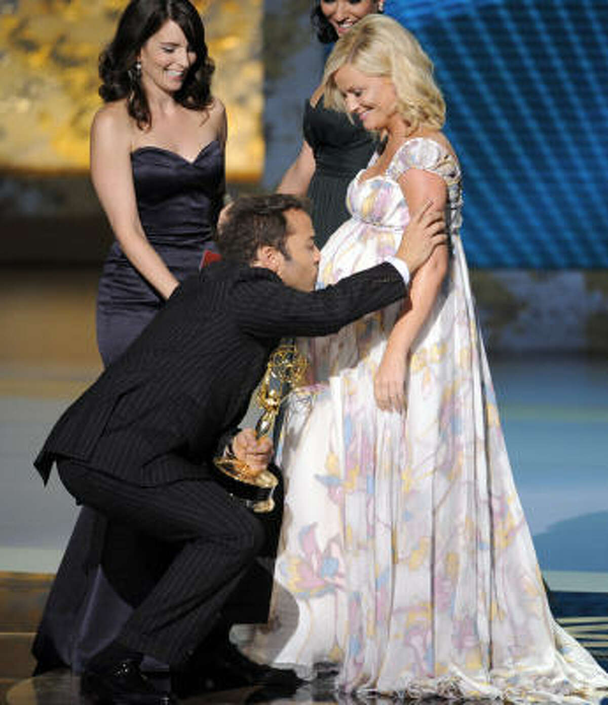 Pregnant bellies are beautiful and highly kissable. Here Jeremy Piven, of Entourage is seen kissing Amy Poehler's belly during the Emmy Awards. In the background is presenter Tina Fey.