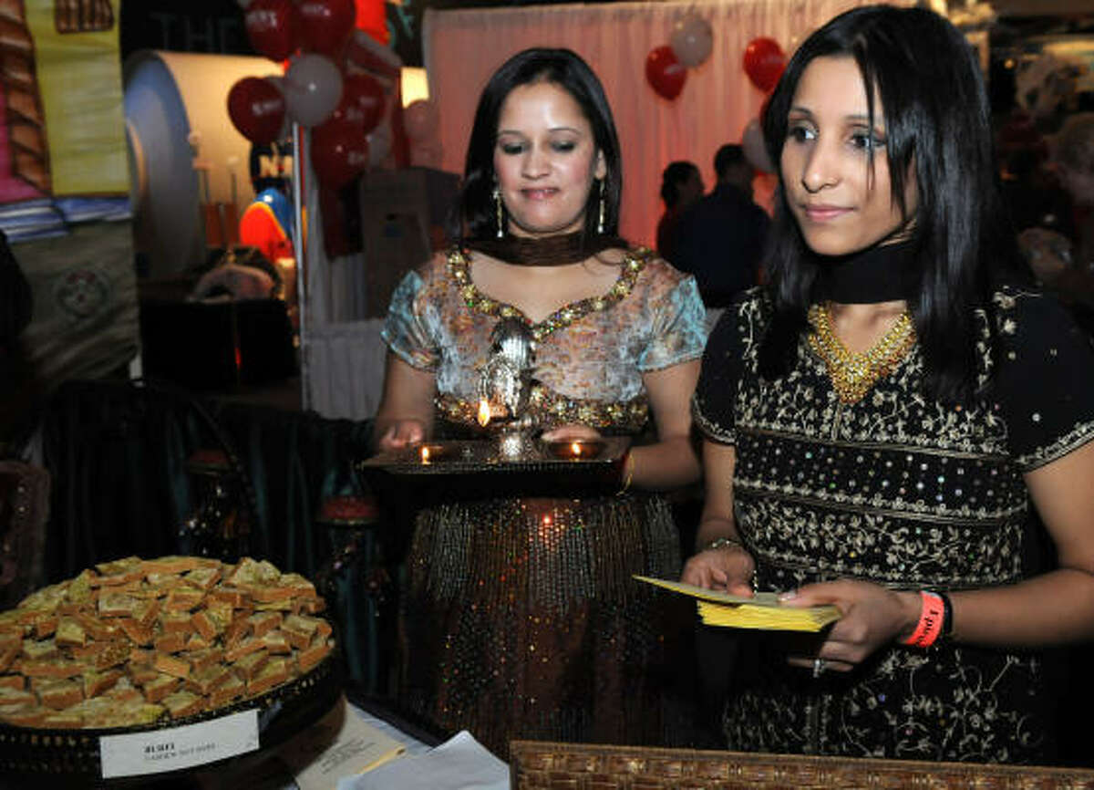 TASTE OF SPACE: Karuna Sharma and Sumnima Karki greet visitors to the Taste of Space event at Space Center Houston.