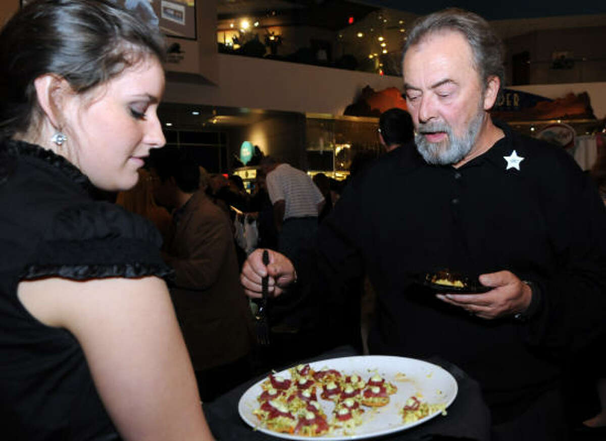 Amber Richardson with Bailey America Grill serves Roy Hawk.