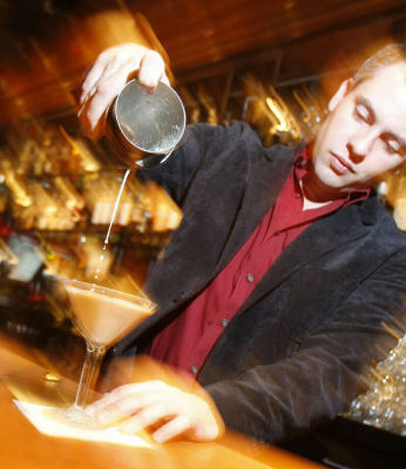 Beau Bedford mixes up a Carameltini recently at Armandos in Houston. This sweet cocktail makes for a nice Valentine's Day drink. Photo: Kevin Fujii, Chronicle