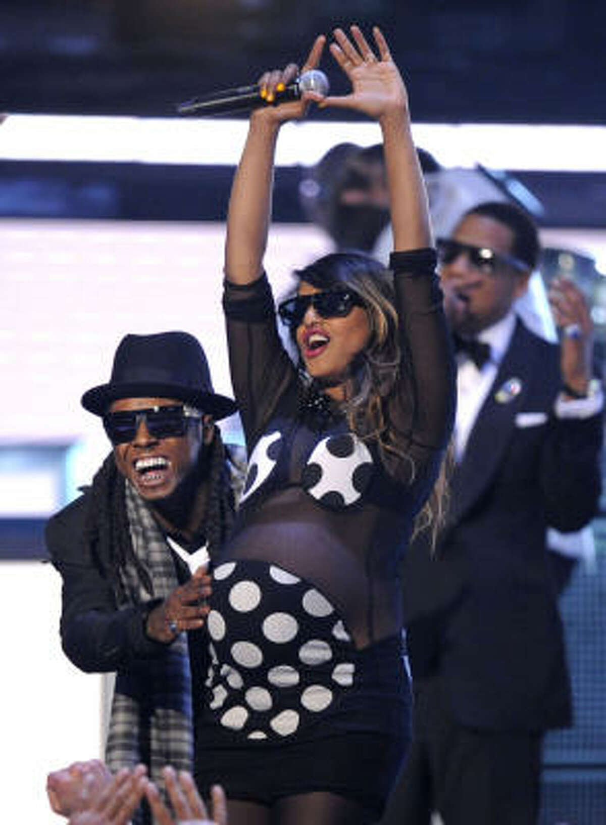 Lil Wayne, left, M.I.A., center, and Jay Z, in background, perform at the 51st Annual Grammy Awards.