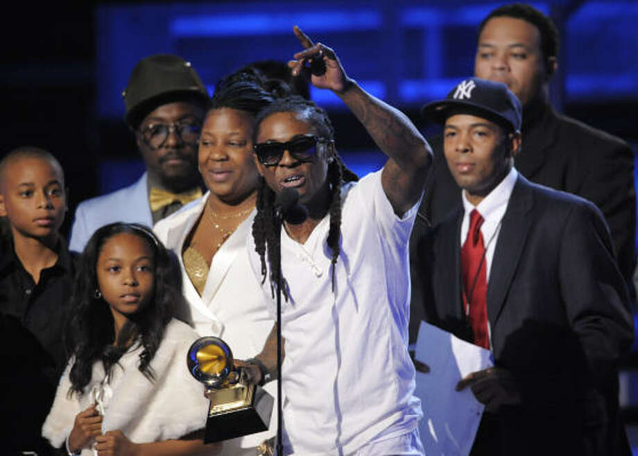 Lil Wayne, center, accepts the award for best rap album. Photo: Mark J. Terrill, AP