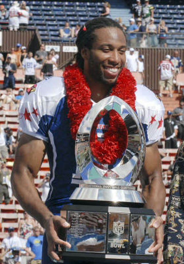 NFC receiver Larry Fitzgerald, of the Arizona Cardinals, holds the MVP trophy after the Pro Bowl. Fitzgerald caught five passes for 81 yards and two touchdowns. Photo: Ronen Zilberman, AP